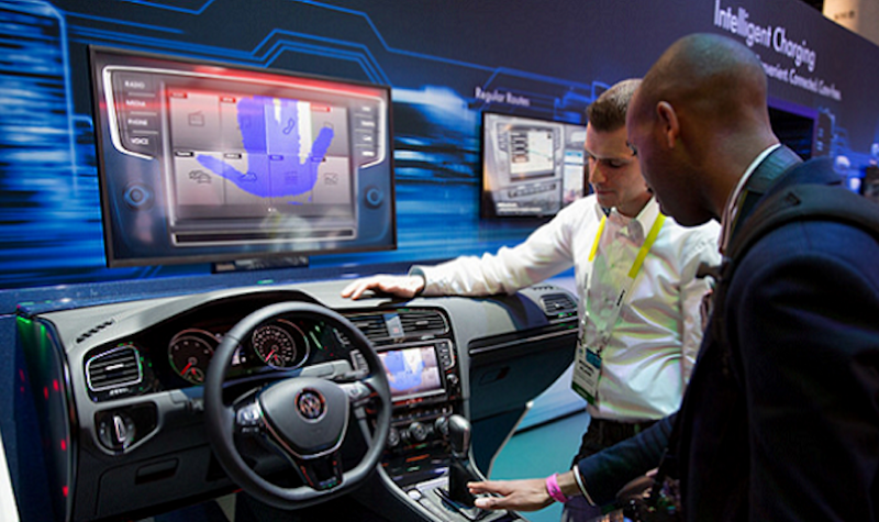 A Man Is Demonstrating Volkswagen Connected Cars Concept