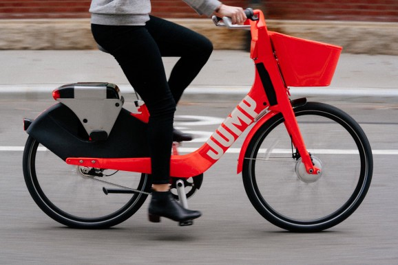 A Woman Is Riding Jump Bikesharing Bicycle