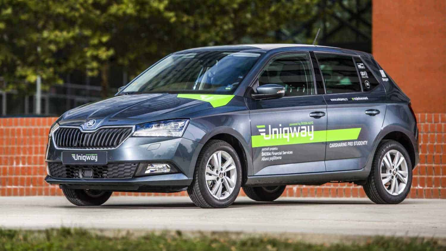 Skoda Carsharing Service Uniqway Vehicle Is Parked Against Brick Wall