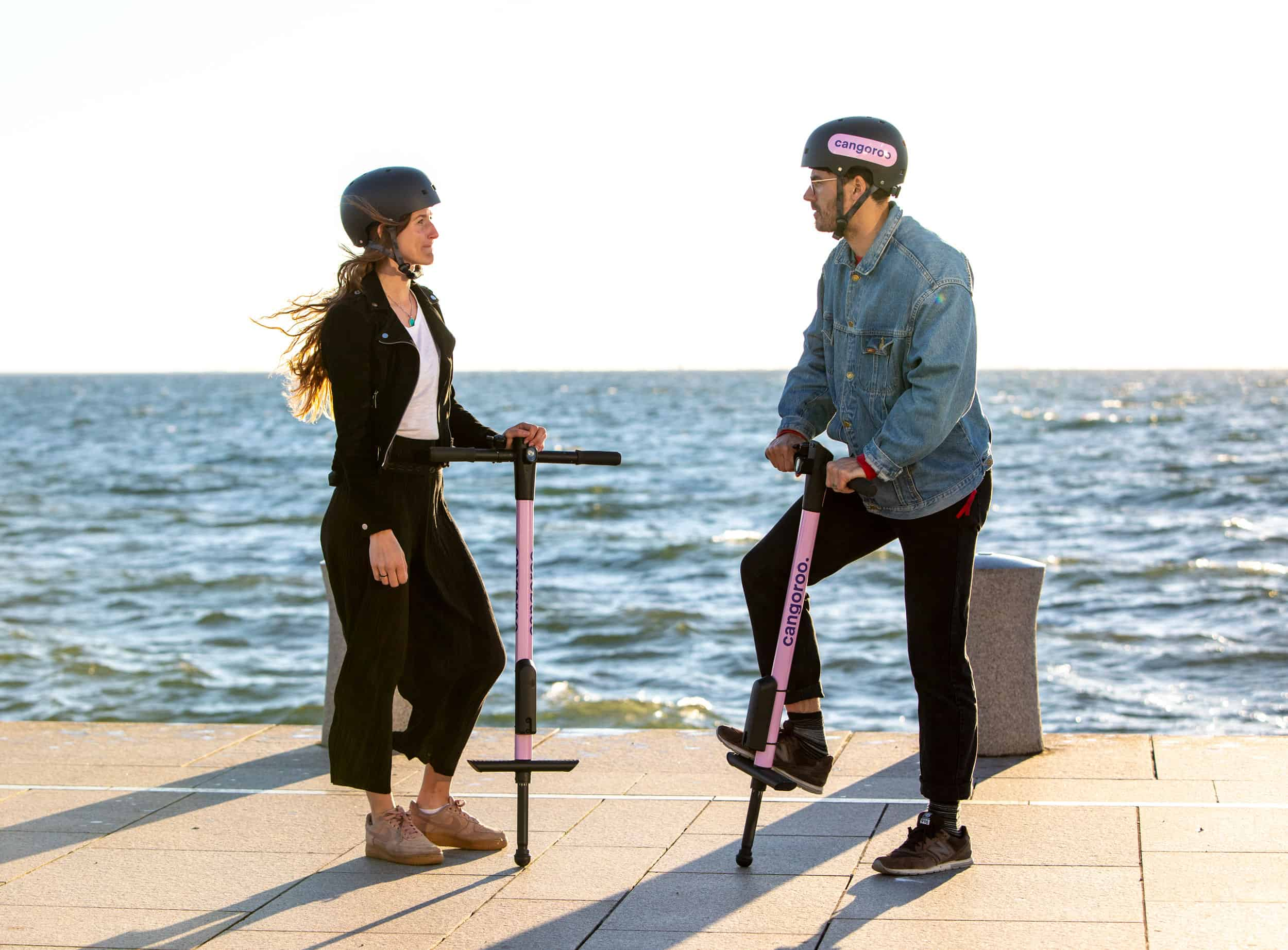 A Man And A Woman On Cangoroo Pogo Sticks