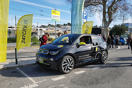 i3 shared car of Hertz 24/7 Portugal is parked on the street