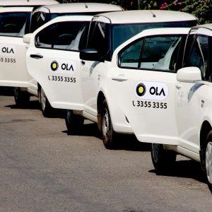 Ola White Taxis In A Row