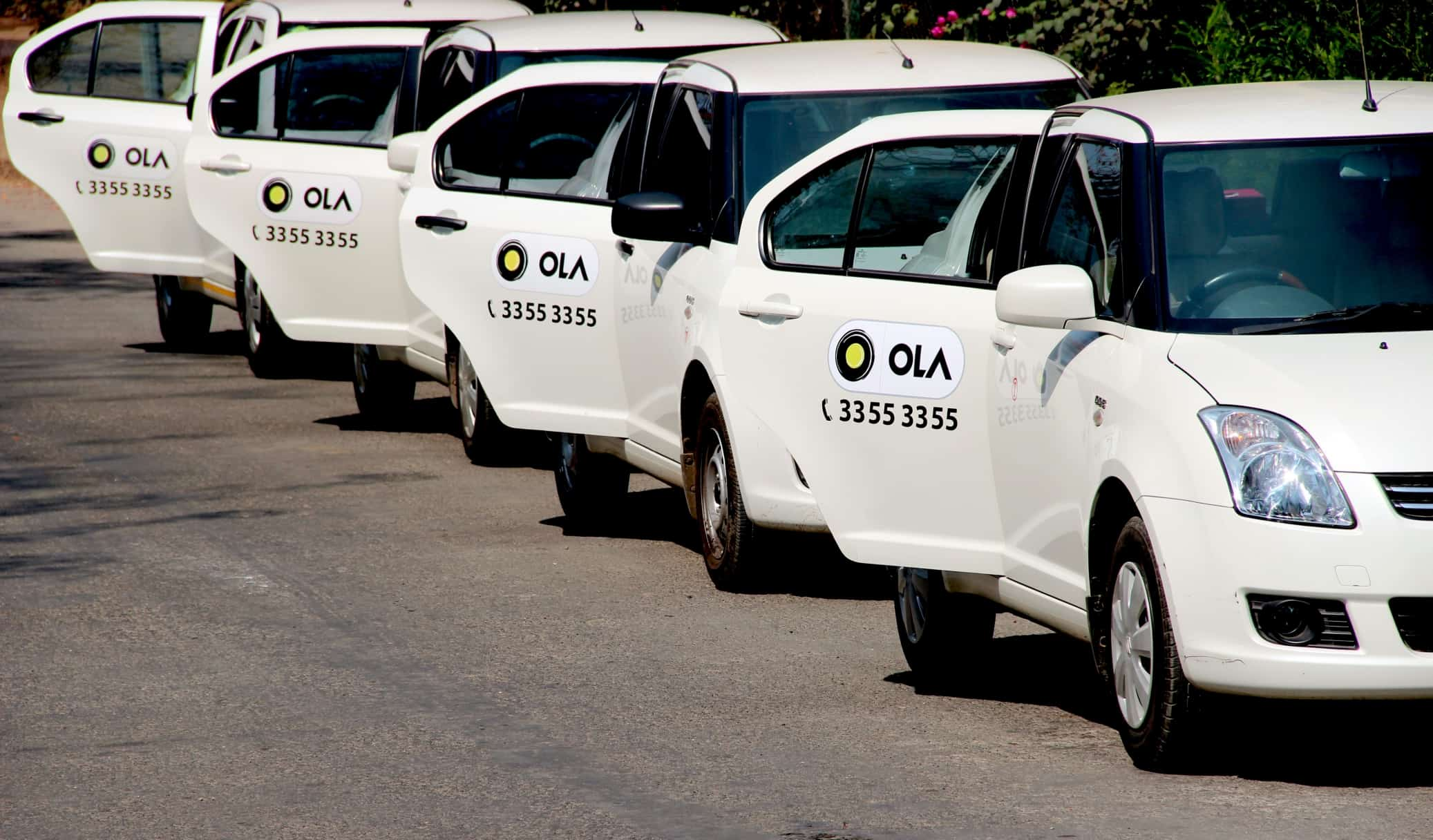 Ola White Taxis In A Row