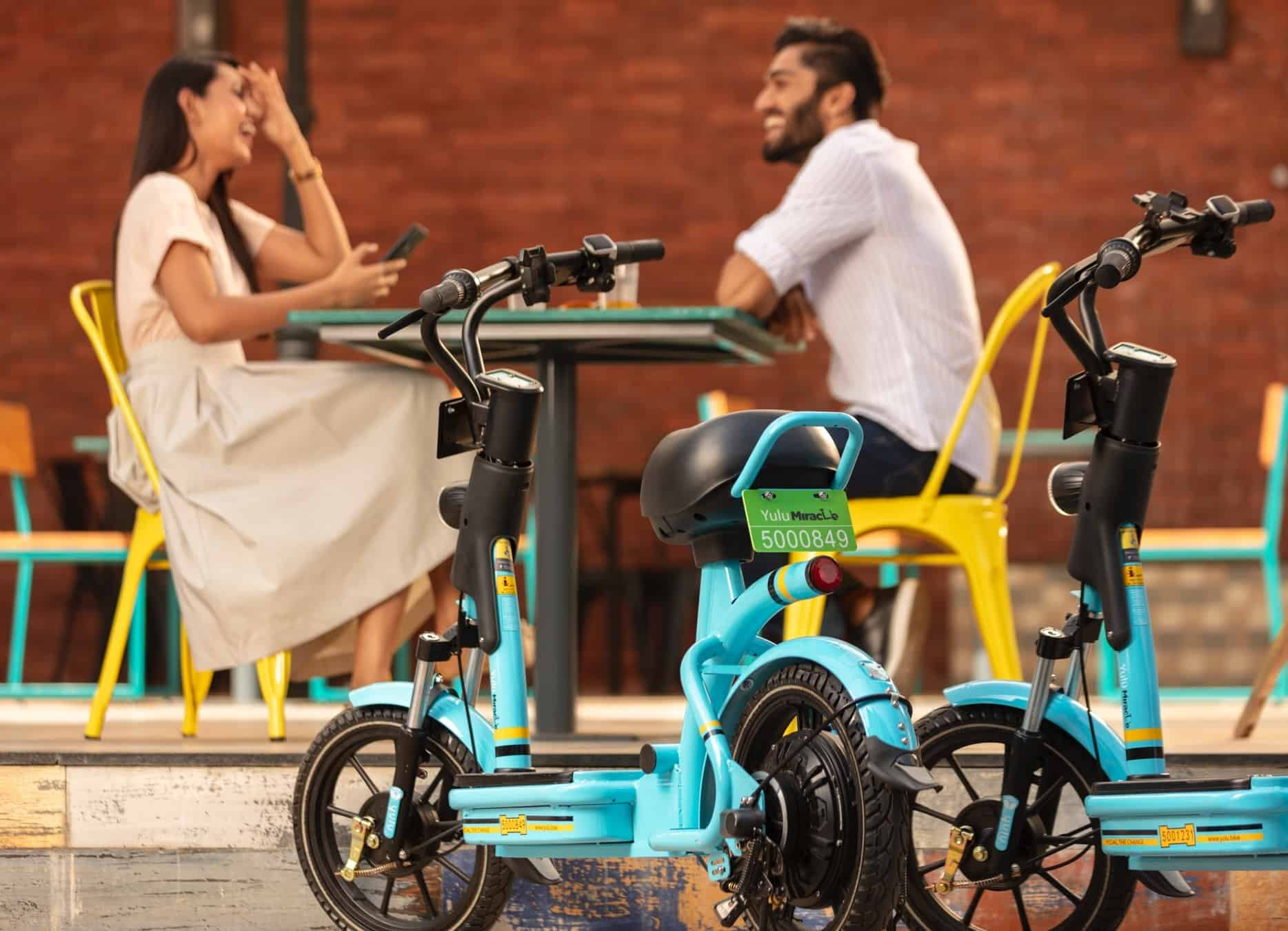 Yulu miracle electric bike with two people having dinner